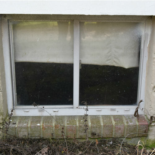 Severn home basement window before replacement