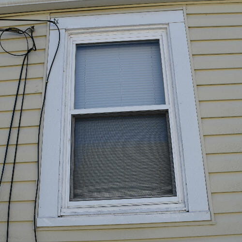 Baltimore home basement window before replacement