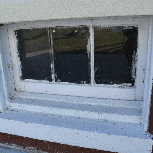 Baltimore home window before replacement